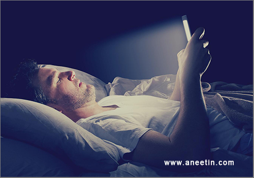 phone and laptop while sleeping